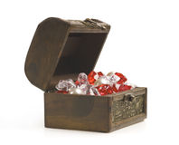Open treasure chest with jewelry isolated on white Stock Photos