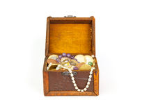 Open treasure chest with jewelry and money Stock Images