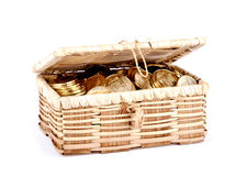 Open treasure chest with money on white Stock Photography