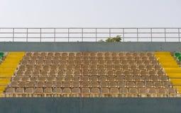 Open tribune section in urban stadium. An image of empty seats of tribune in public open stadium in Antalya city Royalty Free Stock Images