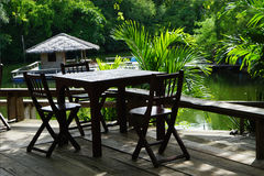 Open tropical restaurant table and chairs Royalty Free Stock Image