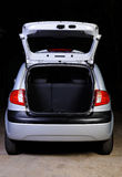 Open trunk of hatchback. Open empty  trunk of hatchback isolated on black Stock Photo