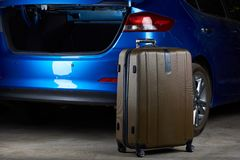 Open trunk of modern car. Luggage suitcase ready for loading Royalty Free Stock Images