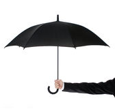 Open umbrella in human hand Stock Photos