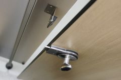 Open unlocked cubicle door ajar at gym changing room. Uk stock photography