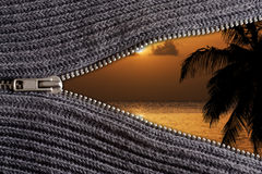 Open up to vacation!. Zip of a wool jacket opens up to a warm dreamy Caribbean location. Sunset with warm colors and palm silhouette Stock Photography