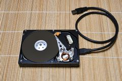 Open USB Hard Disk Drive on wood background Stock Photography