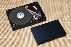 Open USB Hard Disk Drive on wood background Royalty Free Stock Photo