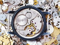 Open used mechanical watch on heap of spare parts Royalty Free Stock Photos