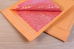 Open used yellow blank envelope with transparent bubble wrap or packaging shockproof. Royalty Free Stock Photo