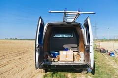 Open van with ladder on top. Stock Photo