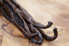 Open vanilla pod on olive board. Close up photo royalty free stock images