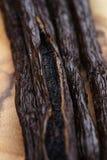 Open vanilla pod on olive board Royalty Free Stock Photo