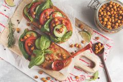 Open vegetarian sandwich with tomato, cucumber, fried chickpeas Royalty Free Stock Photo
