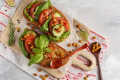 Open vegetarian sandwich with tomato, cucumber, fried chickpeas stock photography
