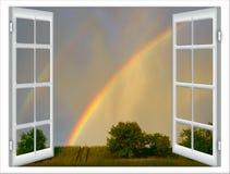 Open vensters met een mening van groene die weide door helder s wordt verlicht stock afbeeldingen