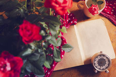Open vintage book and rose Stock Photography