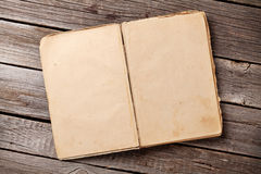 Open vintage book on wood. En background. Top view with copy space Royalty Free Stock Photography