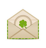 Open vintage envelope with clover  on white background f Stock Image