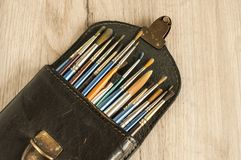Leather case box with paint brushes closeup Stock Image