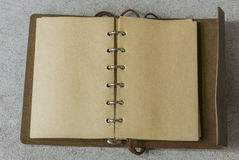 Open vintage leather notebook with handmade paper in modern bind stock images