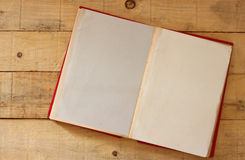Open vintage old book on wooden table Stock Images