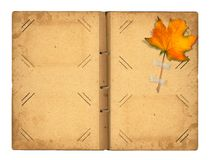 Open vintage photoalbum for photos with autumn foliage Royalty Free Stock Image