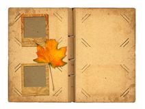 Open vintage photoalbum for photos with autumn foliage Stock Photo