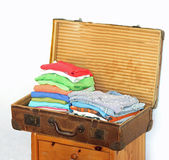 Open vintage suitcase with fold clothes Royalty Free Stock Photos