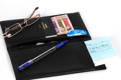 Open wallet. An open wallet with a credit card,bank cheque, customs passport,coin and money Stock Photography