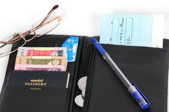 Open wallet. An open wallet with a credit card,bank cheque, customs passport, coin and money Stock Photo