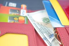 Open wallet with bank cards and dollar bills. royalty free stock photography