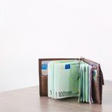Open wallet with euro currency on the wooden table Royalty Free Stock Images
