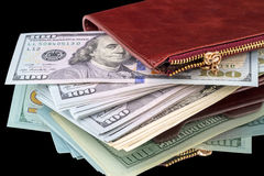 Open wallet with a pack of dollars Stock Photos