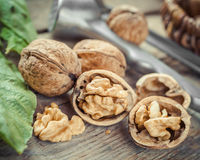 Open walnut close up, nutcracker and basket on background Stock Images