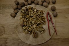 Open the walnuts. With the nutcracker Royalty Free Stock Images