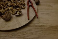 Open the walnuts. With the nutcracker Royalty Free Stock Photography