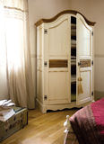 Open wardrobe in bedroom Royalty Free Stock Photo