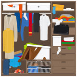 Open wardrobe with mess clothes Stock Images