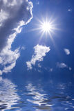 Open water. Sun and clouds over open sea stock image