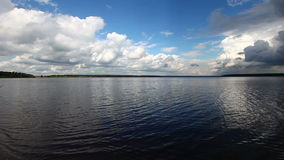 Open water and cloudscape at summer day Royalty Free Stock Image