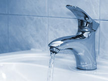 Open water faucet. Water running from an open water faucet Royalty Free Stock Image