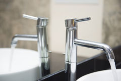 Open water from the faucet in the basin Royalty Free Stock Images