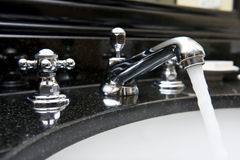 Open water from faucet Stock Photo