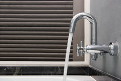 Open water from faucet in bathroom Royalty Free Stock Image