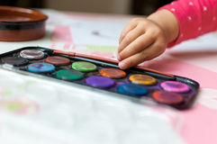 Open watercolor paint tray on table Royalty Free Stock Photography
