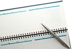 Open weekly planner with ballpen. Stock Images