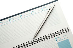 Open weekly planner with ballpen. Royalty Free Stock Image