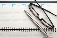 Open weekly planner with ballpen. Stock Image
