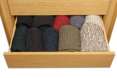 Open a well-organized drawer box, top view, white background. A well-organized closet drawer open. Storage system. Wardrobe order with white background, top view royalty free stock image